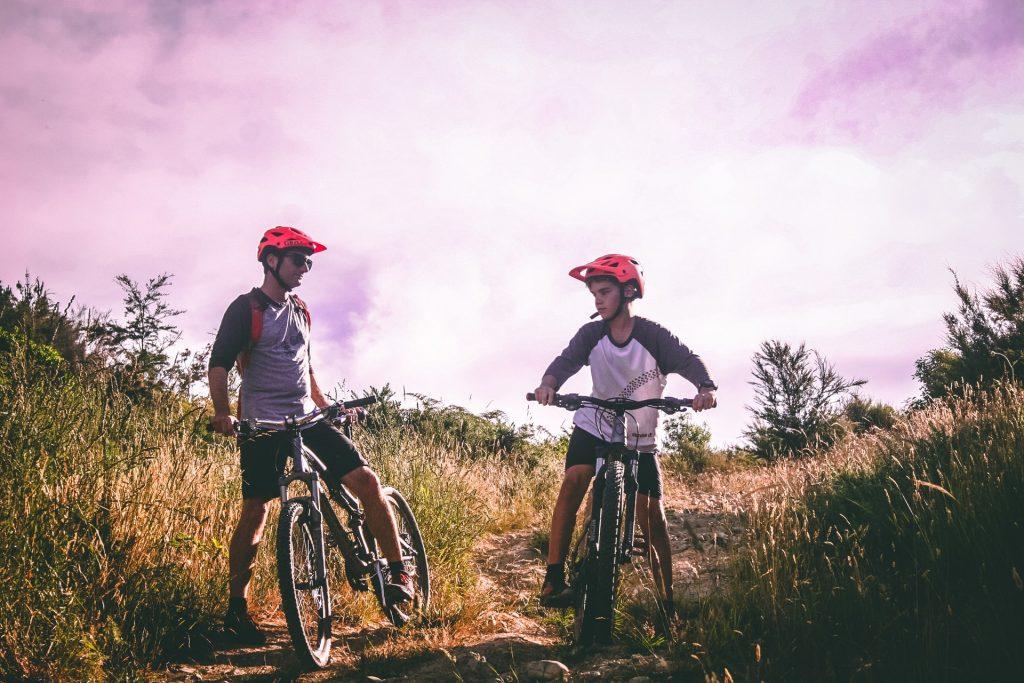 Two guys riding mountain bikes