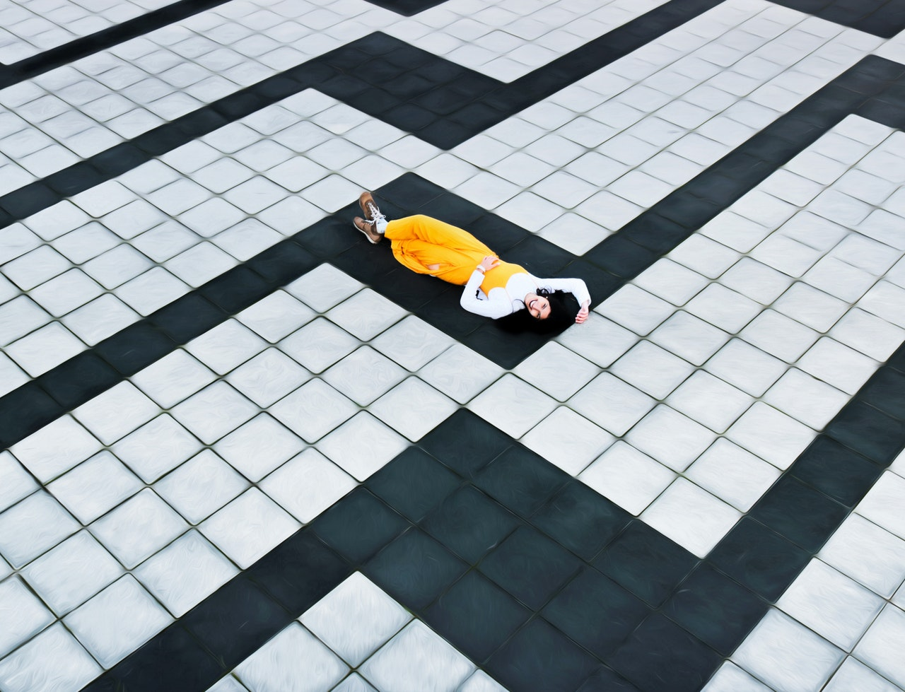 Woman lying on a floor made with tiles